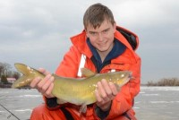 One of the few catfish caught in cold, wet conditions (50° F Water Temp).